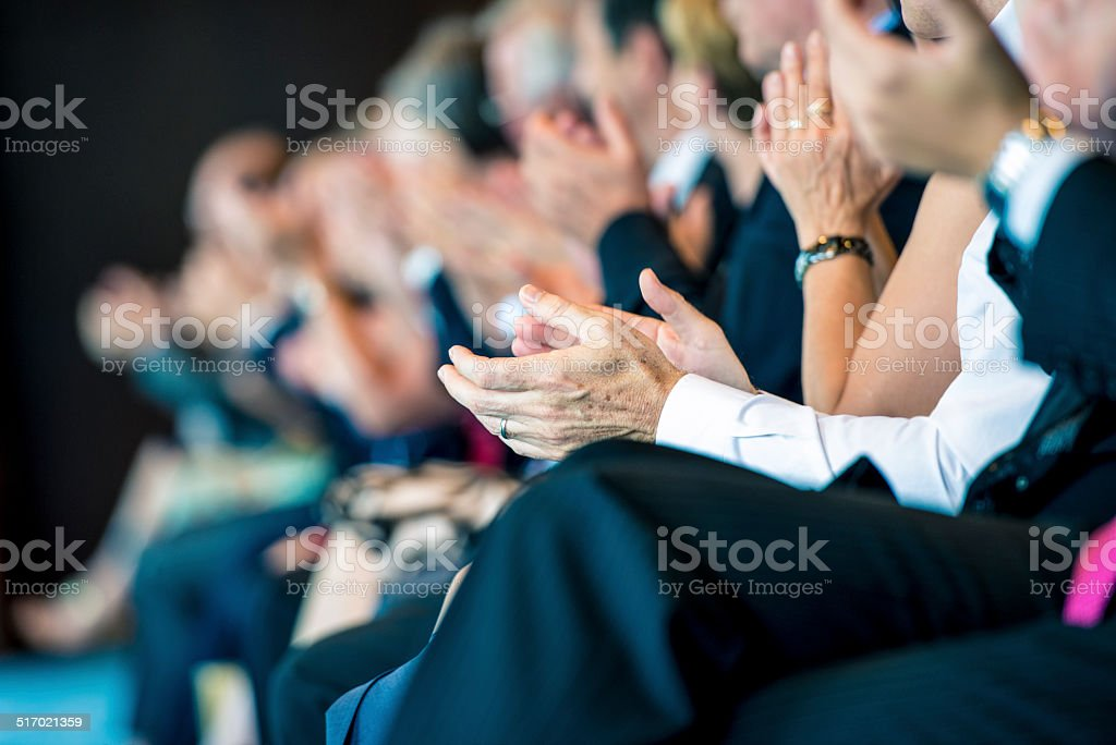 Businesspeople applauding stock photo