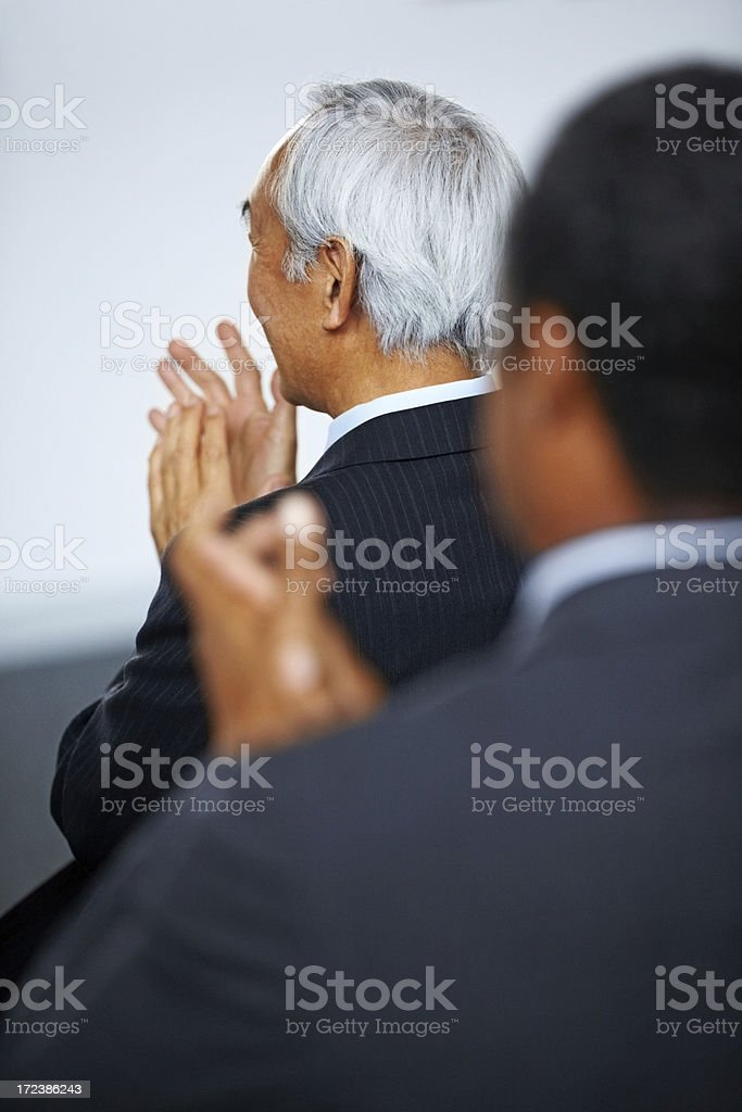 Businesspeople applauding presentation royalty-free stock photo