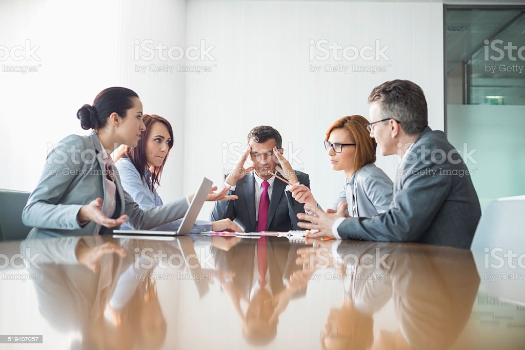 Businesspeople arguing in meeting stock photo
