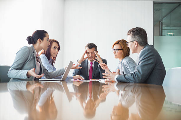 businesspeople arguing in meeting - fighting stock photos and pictures