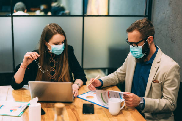Businesspeople at work during COVID-19 pandemic stock photo