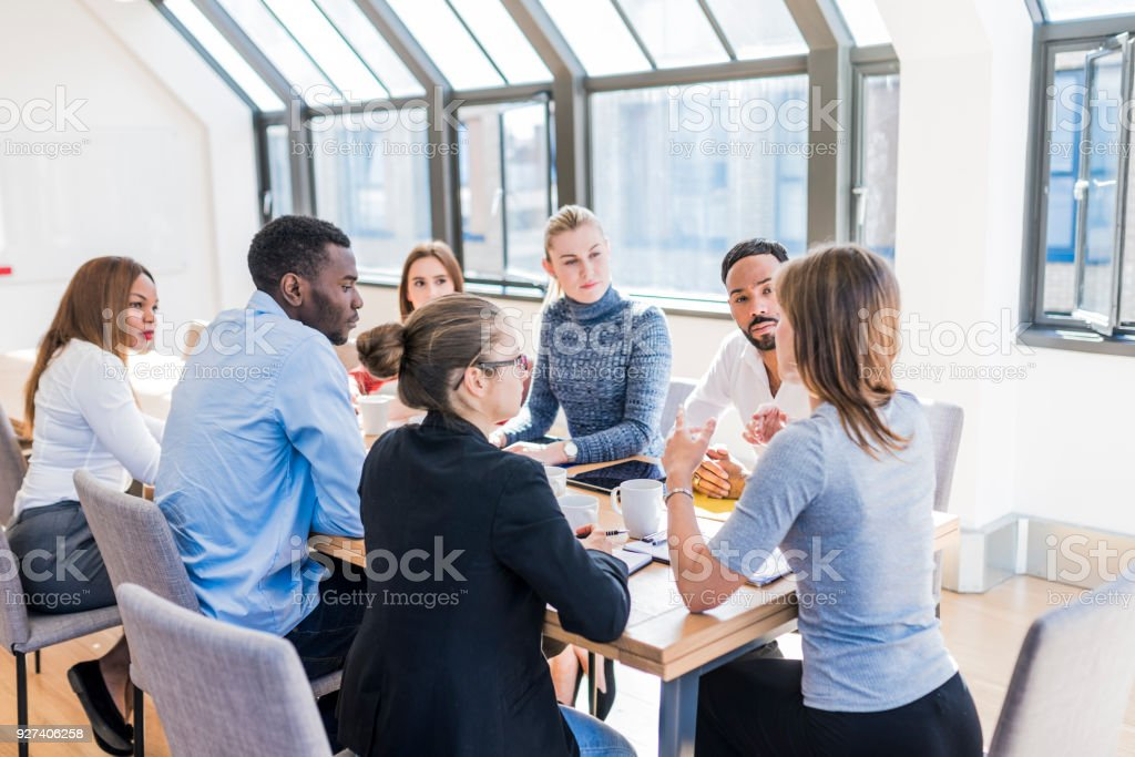 Businesspeople brainstorming new business ideas stock photo