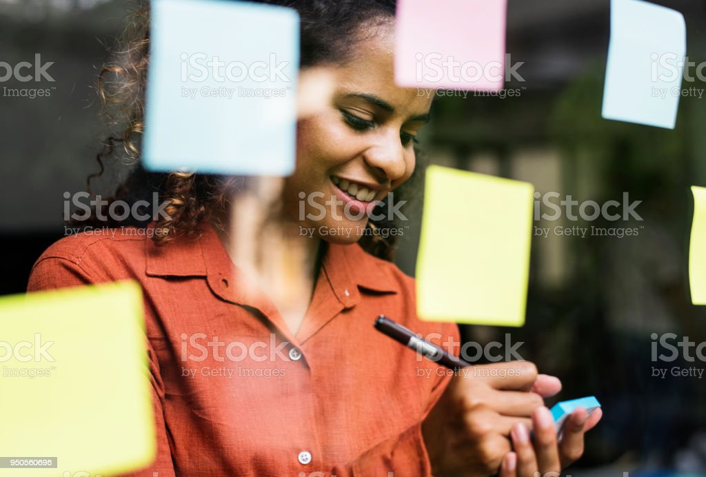 Businesspeople brainstorming with creative ideas stock photo