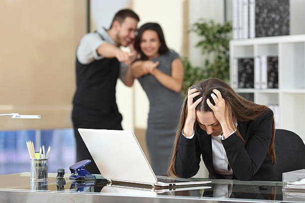 businesspeople bullying a colleague at office - disdainful stock pictures, royalty-free photos & images