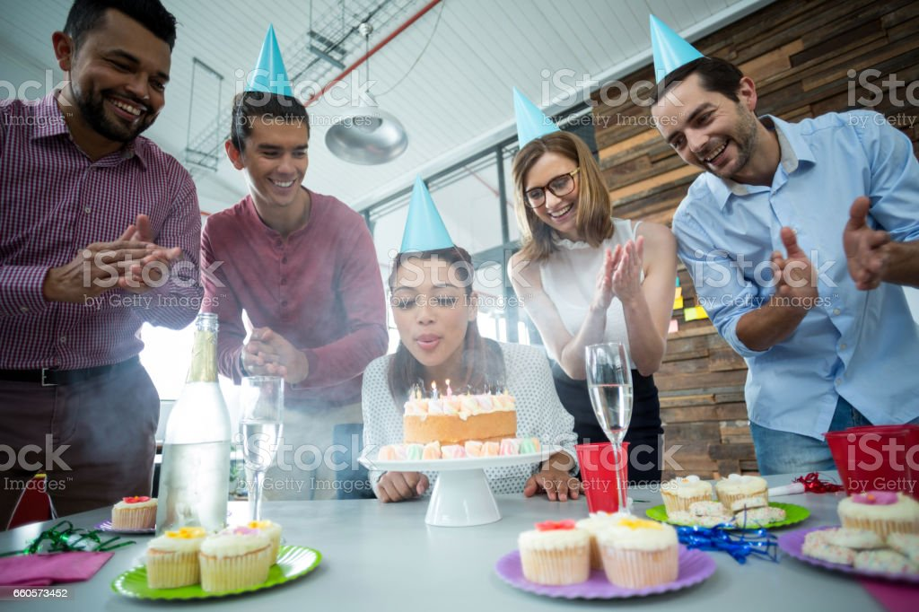 Businesspeople celebrating their colleagues birthday stock photo
