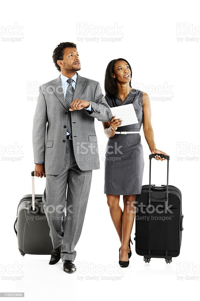 Businesspeople checking their flight timing royalty-free stock photo
