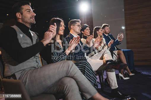 639200924 istock photo Businesspeople clapping at the conference host 1197388869
