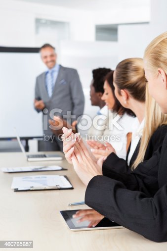1087253494 istock photo Businesspeople Clapping For A Man In Meeting 460765687