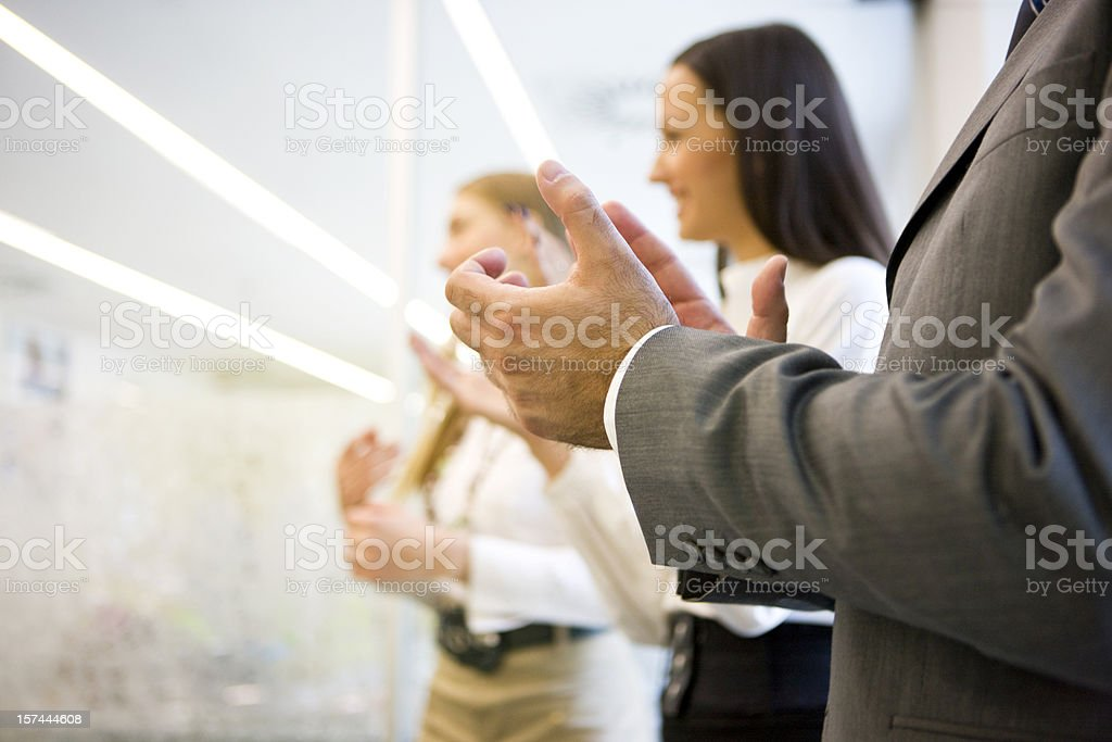 Businesspeople clapping stock photo