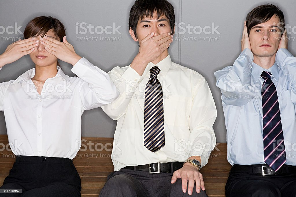 Businesspeople covering their eyes mouths and ears stock photo