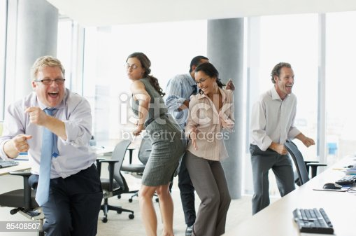 istock Businesspeople dancing in office 85406507