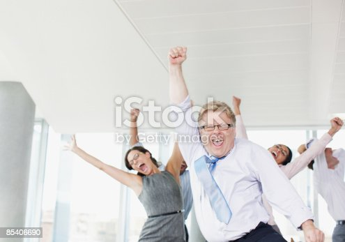 istock Businesspeople dancing in office 85406690