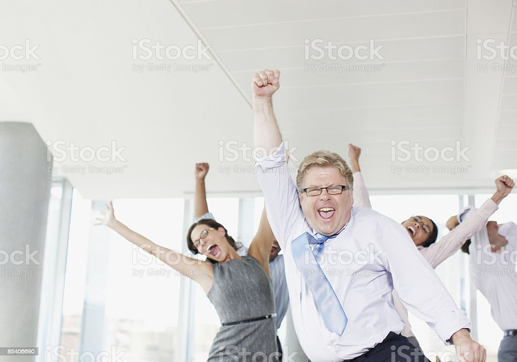 Businesspeople dancing in office stock photo