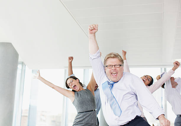 businesspeople dancing in office - public celebratory event stock photos and pictures