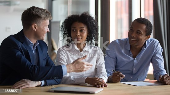 istock Businesspeople discussing contract at meeting, manager consulting clients 1138382711