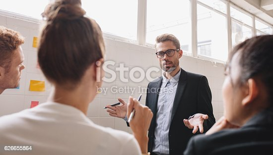 istock Businesspeople discussing in work in meeting room 626655864