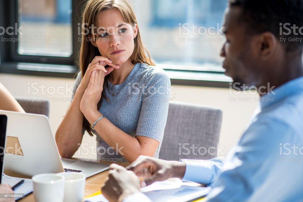 Businesspeople discussing new ideas in the board room stock photo