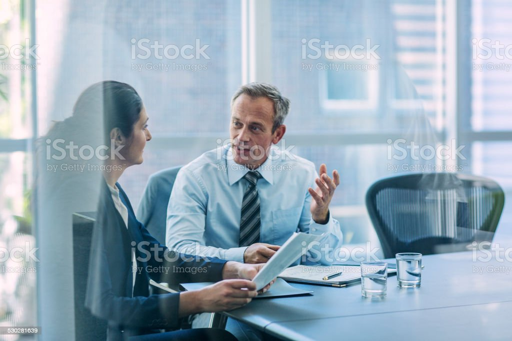 Businesspeople discussing strategy in office stock photo