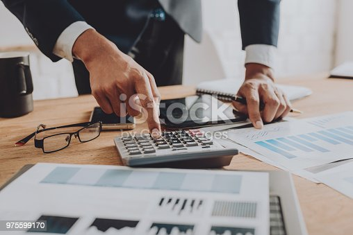 istock Businesspeople discussing the charts and graphs,businessmen discussing on stockmarket document in office,Business concept. 975599170