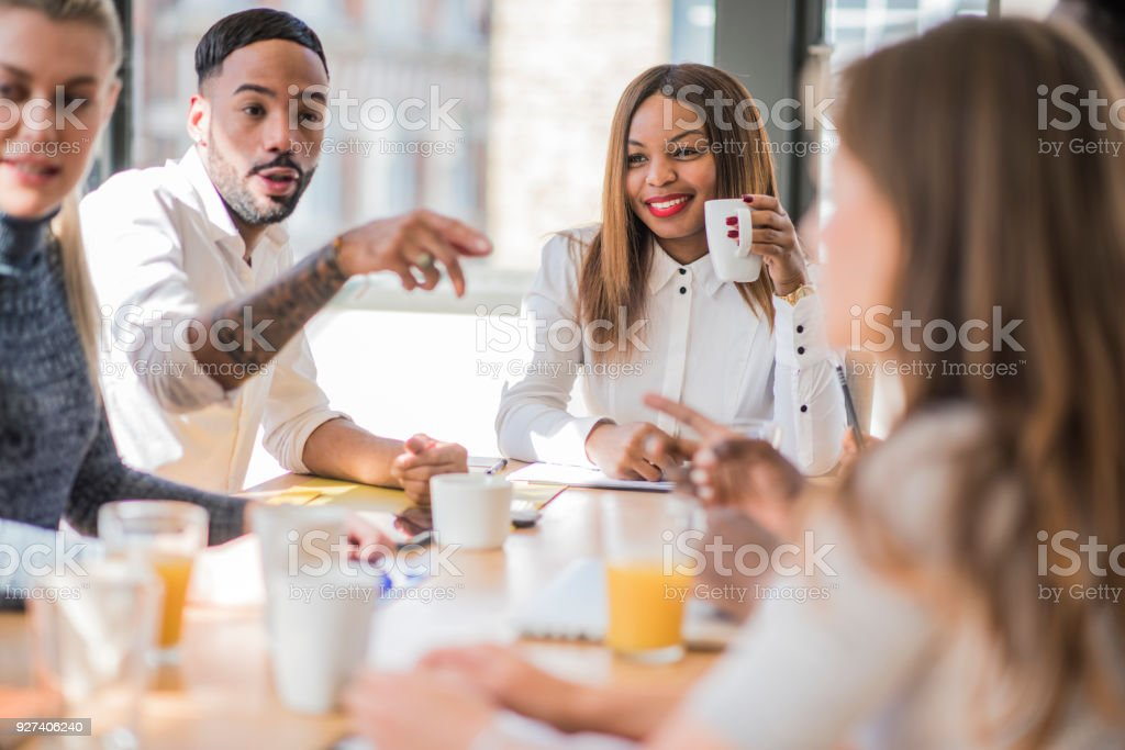 Businesspeople discussing the new business strategy stock photo