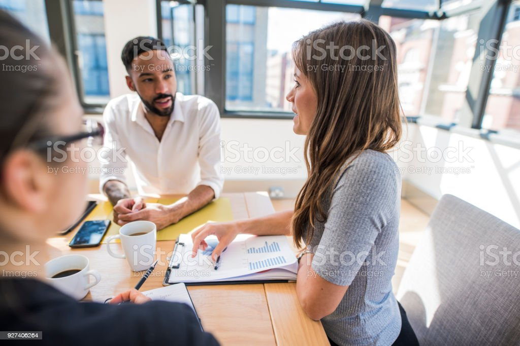 Businesspeople discussing the new strategy stock photo