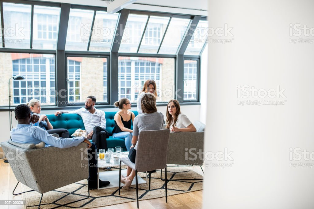 Businesspeople discussing their future plans in the office stock photo