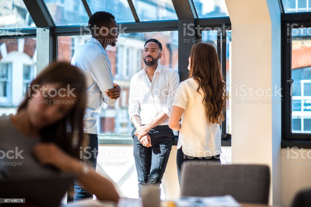Businesspeople discussing their success stock photo