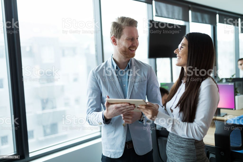 Businesspeople discussing while using digital tablet in office royalty-free stock photo