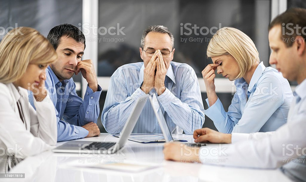 Businesspeople expressing stress at work stock photo