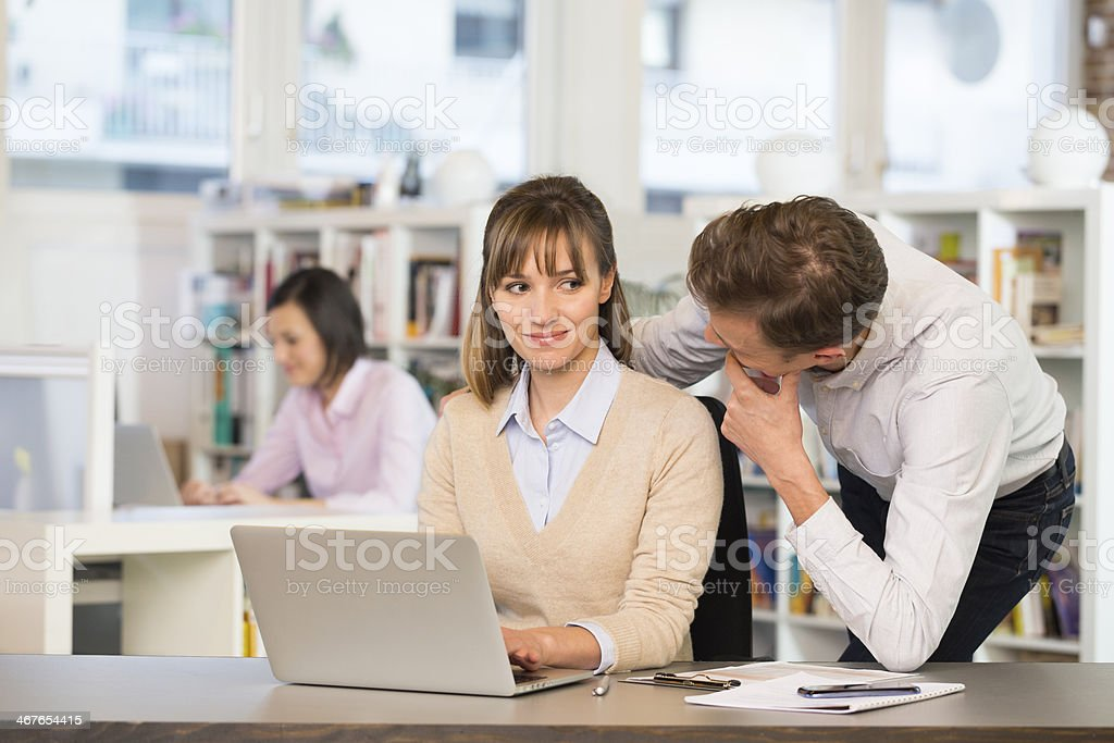 Businesspeople flirting at work in office royalty-free stock photo