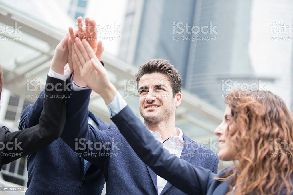 businesspeople give five Lizenzfreies stock-foto