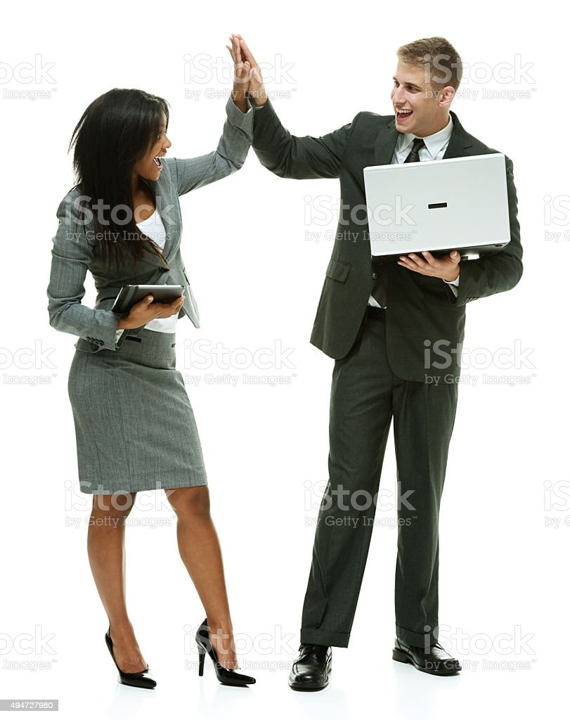 Businesspeople giving high five stock photo