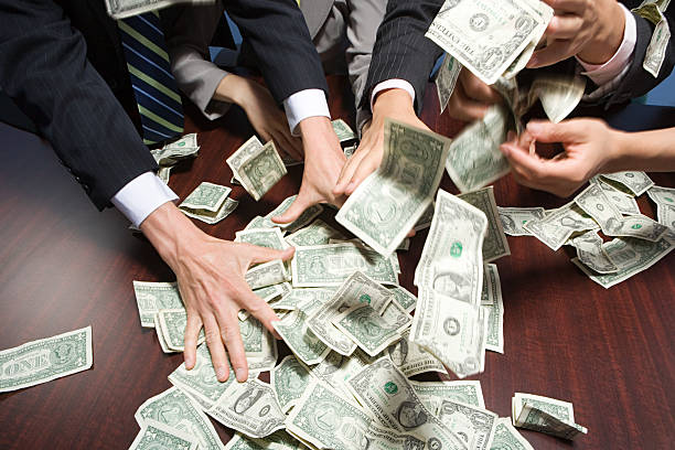 Businesspeople grabbing money stock photo