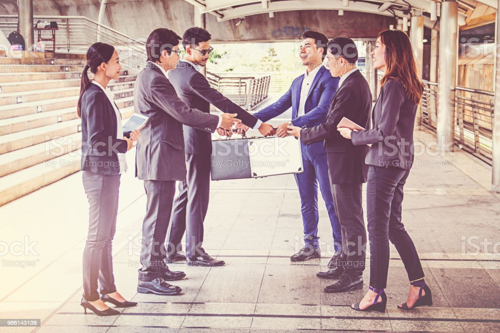 businesspeople group handshake at city, business team - Стоковые фото Бизнес роялти-фри