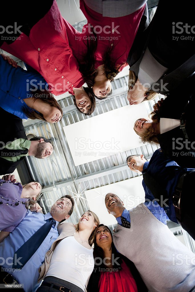 Businesspeople Group in Team Circle, Laughing and Smiling stock photo