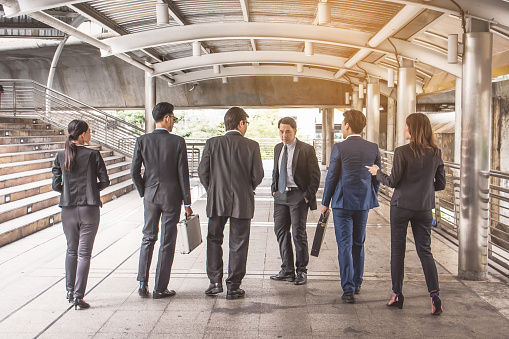 Businesspeople Group Talking At City Business Team Stock Photo - Download Image Now