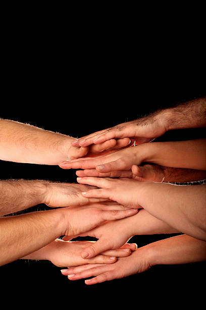 businesspeople hands clasped for teamwork stock photo