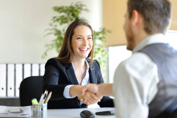 Businesspeople handshaking after deal or interview stock photo