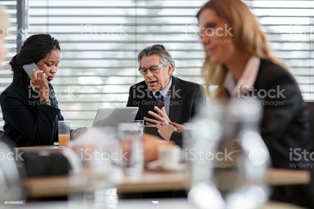 Businesspeople Have Meeting In Restaurant stock photo