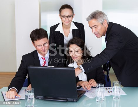 istock Businesspeople having a discussion 166510064