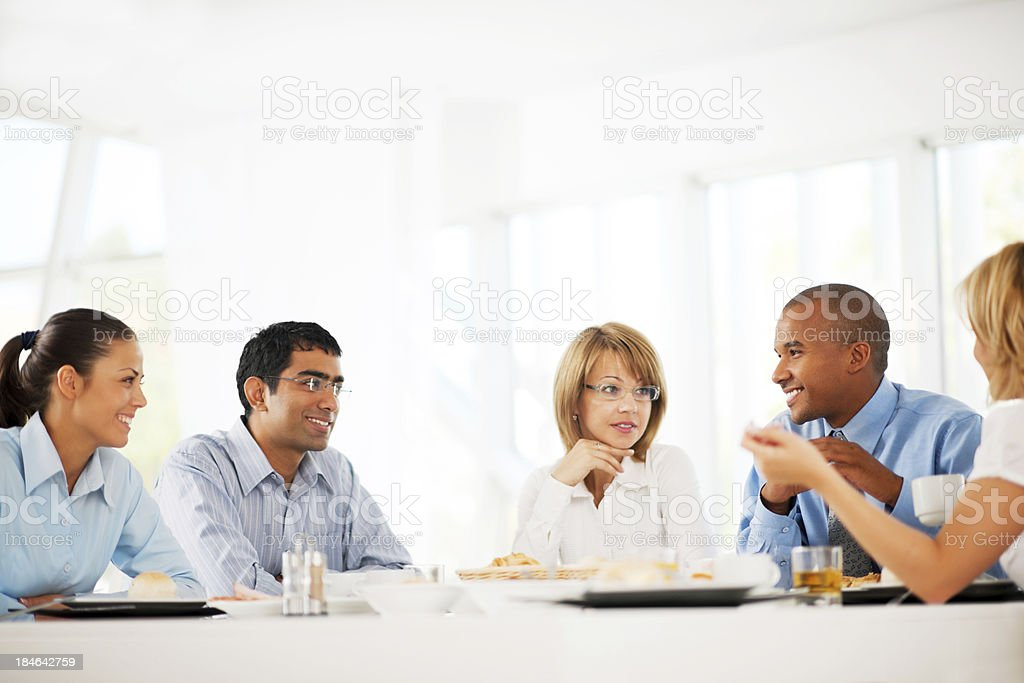 Businesspeople having a lunch break. stock photo