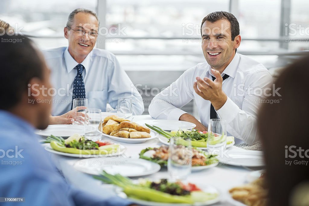 Businesspeople having business lunch. stock photo