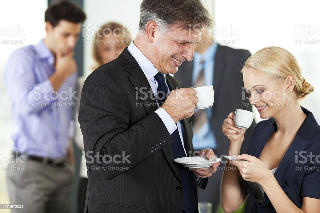 Businesspeople having coffee break royalty-free stock photo