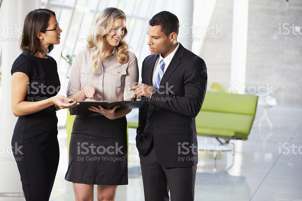 Businesspeople Having Informal Meeting In Modern Office stock photo
