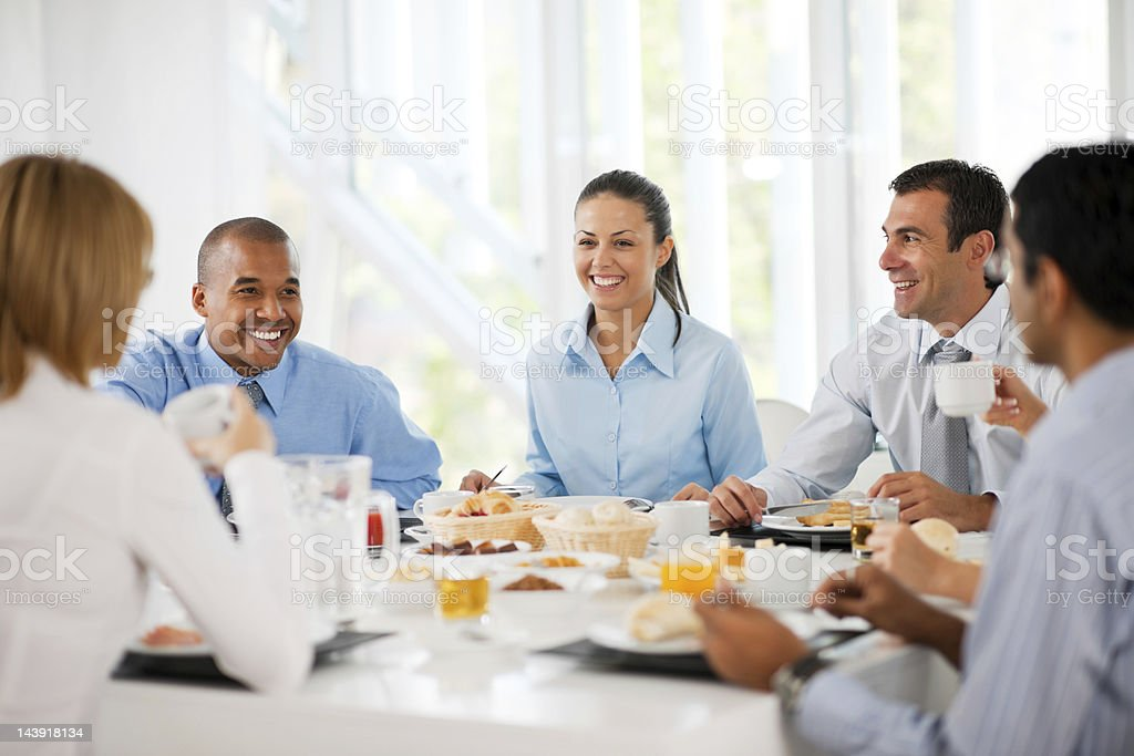 Businesspeople having lunch indoors. stock photo