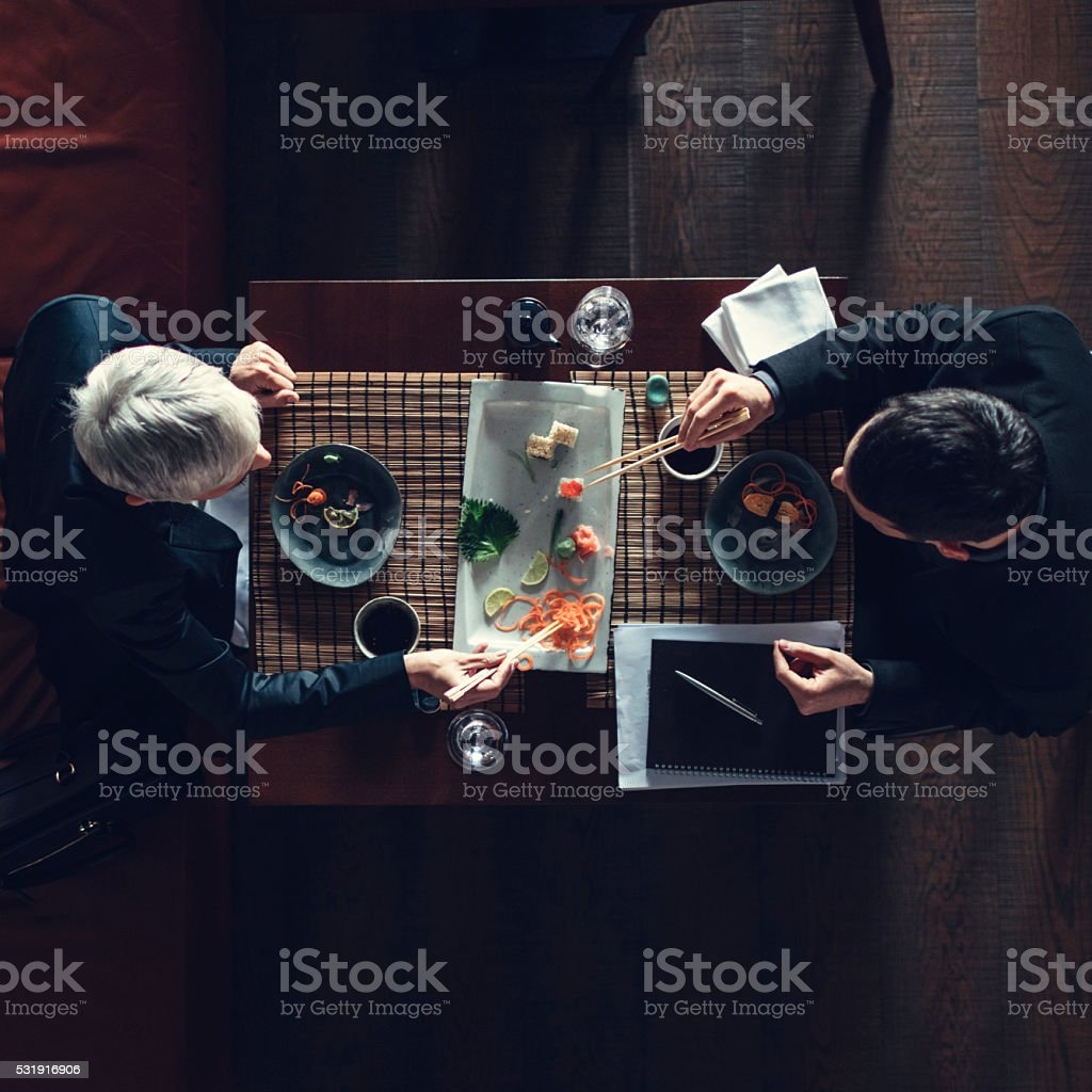 Businesspeople Having Lunch Together stock photo