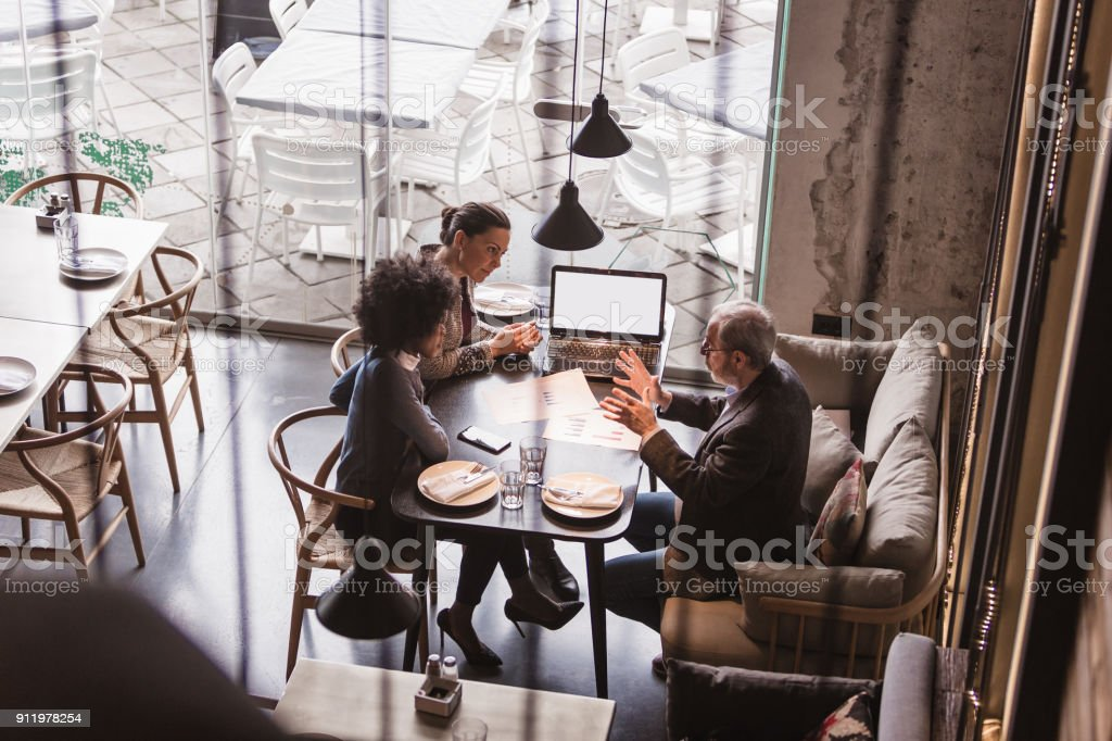 Businesspeople Having Meeting In A Restaurant. stock photo