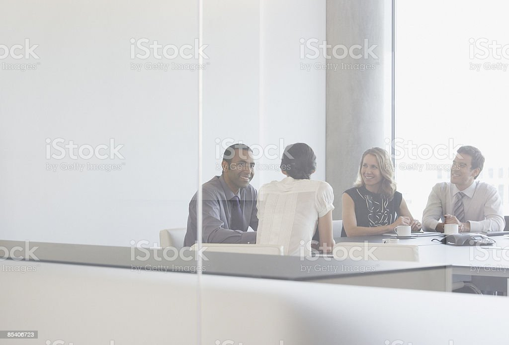 Businesspeople having meeting in conference room royalty-free stock photo
