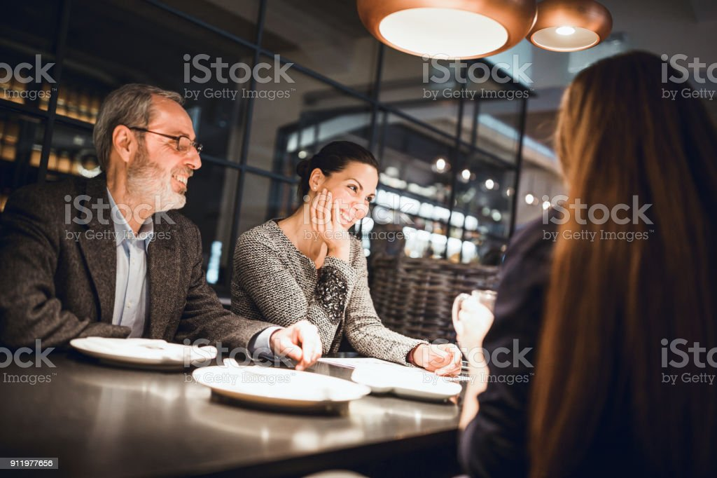 Businesspeople having meeting in in high end restaurant stock photo