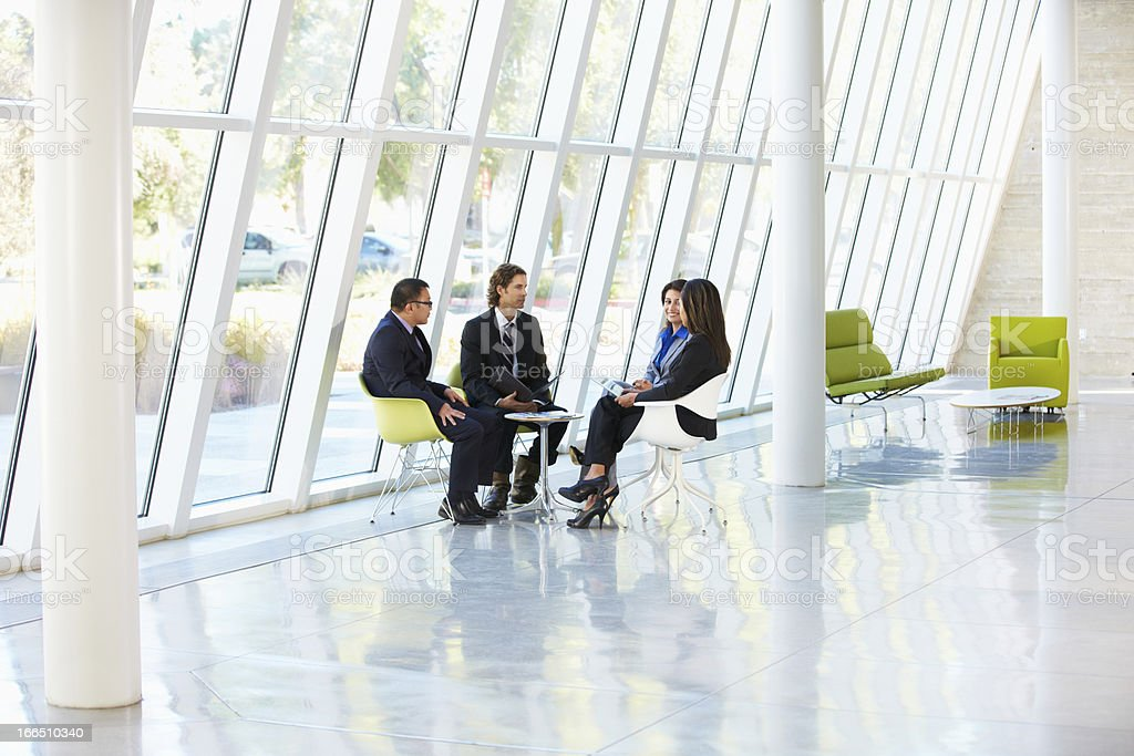Businesspeople Having Meeting In Office royalty-free stock photo